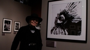 Jini Dellaccio with her portrait of Neil Young at Taking Aim exhibit, Seattle 2010