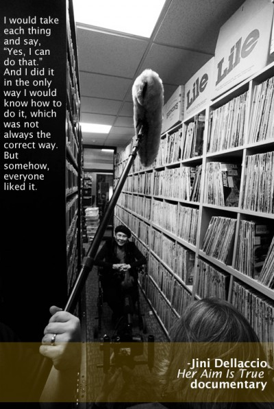 Jini Dellaccio, surrounded by records at KEXP, Seattle, after reuniting with The Sonics!